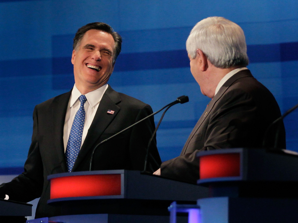 Republican Presidential candidates, former Massachusetts Gov. Mitt Romney (L) and former U.S. House Speaker Newt Gingrich (R-GA) share a laugh during a Fox News, Wall Street Journal-sponsored debate at the Myrtle Beach Convention Center, on January 16, 2012 in Myrtle Beach, South Carolina.