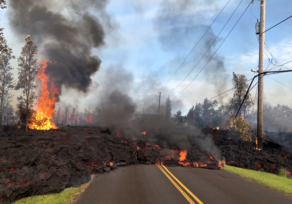 In this handout photo provided by the U.S. Geological Survey, lava from a fissure slowly advances to the northeast on Hookapu Street after the eruption of Hawaii's Kilauea volcano on May 5, 2018 in the Leilani Estates subdivision near Pahoa, Hawaii.