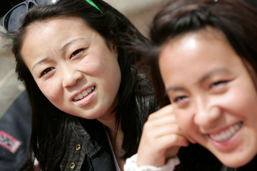 Jessica Peng, left, and Lauren Sit talk about proposed college admissions guidelines affecting Asian students at Lowell High School in San Francisco, Thursday, April 23, 2009.
