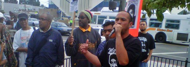 Aigge Patterson leads a protest at Leimert Park against the involuntary manslaughter verdict in the Mehserle case
