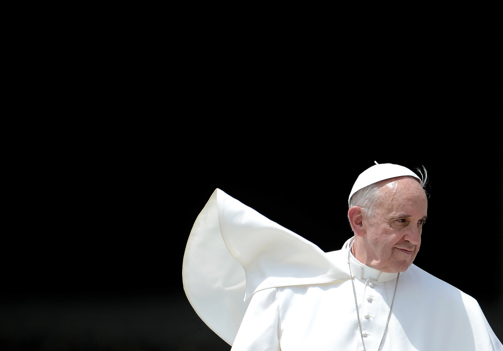 Pope Francis leaves after his weekly general audience in St. Peter's square at the Vatican on May 22, 2013.