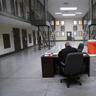 "A guard sits in the ""segregation block"" at the Adelanto Detention Facility on November 15, 2013 in Adelanto, California. According to a report released Monday by the American Civil Liberties Union,  more than two-thirds of immigrants detained for more than six months in the Los Angeles area were deemed to be eligible for bond once they received a hearing before a judge."