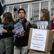 Activists rally to call for the removal of Superior Court Judge Aaron Persky in San Francisco in June over his ruling in a sexual assault case. On Friday, the judge was transferred from criminal to civil court.