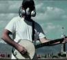 Josh Fox wears gas mask and plays banjo in 'Gasland.'