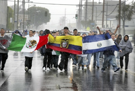 Students march in streets carrying latin american flags to protest against a proposed immigration policy March 28, 2006 in Los Angeles, California