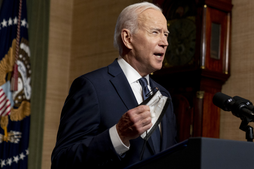 U.S. President Joe Biden removes his mask to speak from the Treaty Room in the White House about the withdrawal of U.S. troops from Afghanistan on April 14, 2021 in Washington, DC.