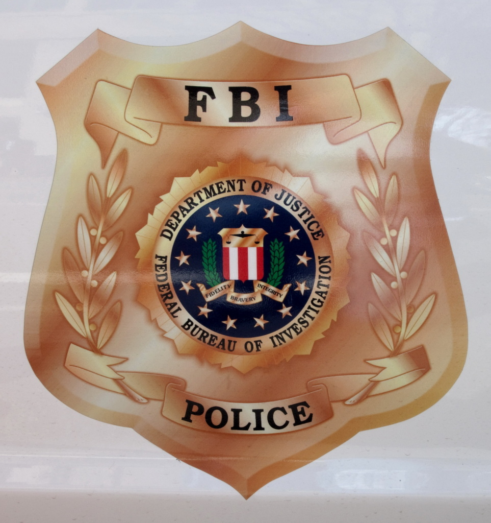 An FBI undercover officer allegedly bought sealed documents from the court clerk's husband.