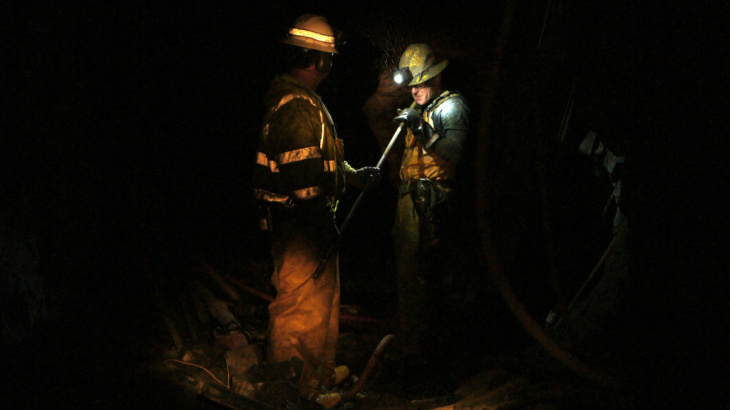 Miner Steve Ator cleans a drill bit inside the Lincoln Project Mine, in Sutter Creek, Calif.