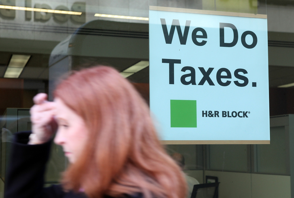 A pedestrian walks by an H & R Block office on April 15, 2011 in San Francisco.