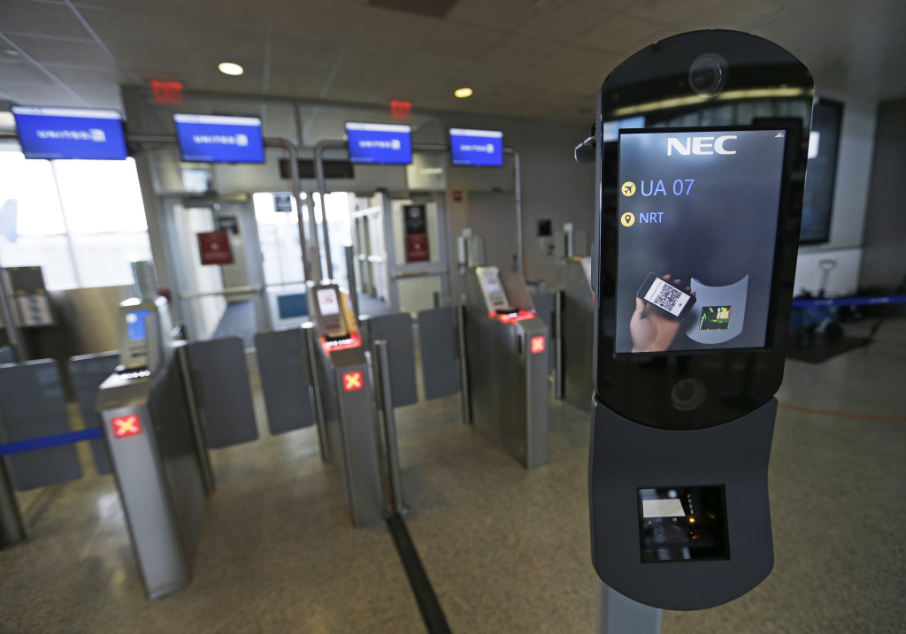 File: A U.S. Customs and Border Protection facial recognition device is ready to scan another passenger at a United Airlines gate, Wednesday, July 12, 2017, at George Bush Intercontinental Airport, in Houston.