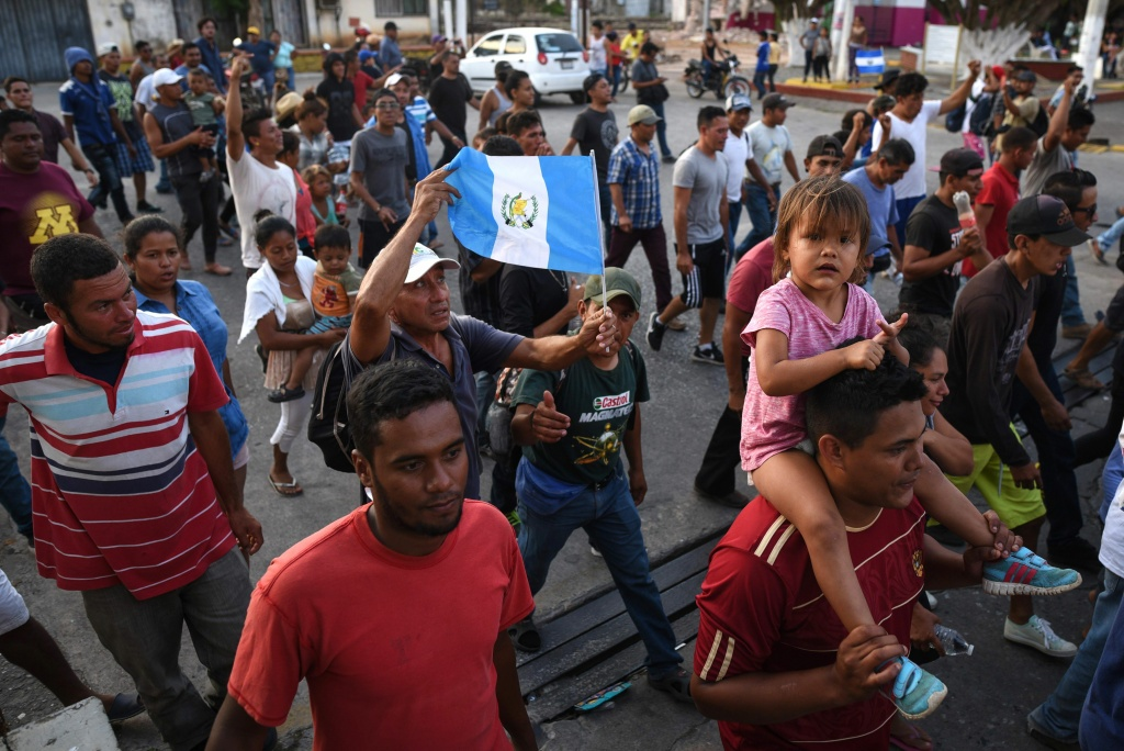 A migrant -alongside other Central Americans taking part in a caravan called