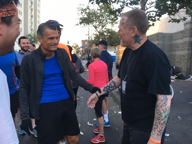Judge Craig J. Mitchell (second from left) greets Skid Row Running Club member Ben Shirley in downtown Los Angeles.