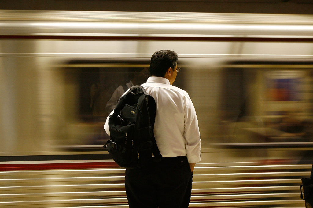File: Passengers board Metrolink subway trains during rush hour on June 3, 2008 in Los Angeles.
