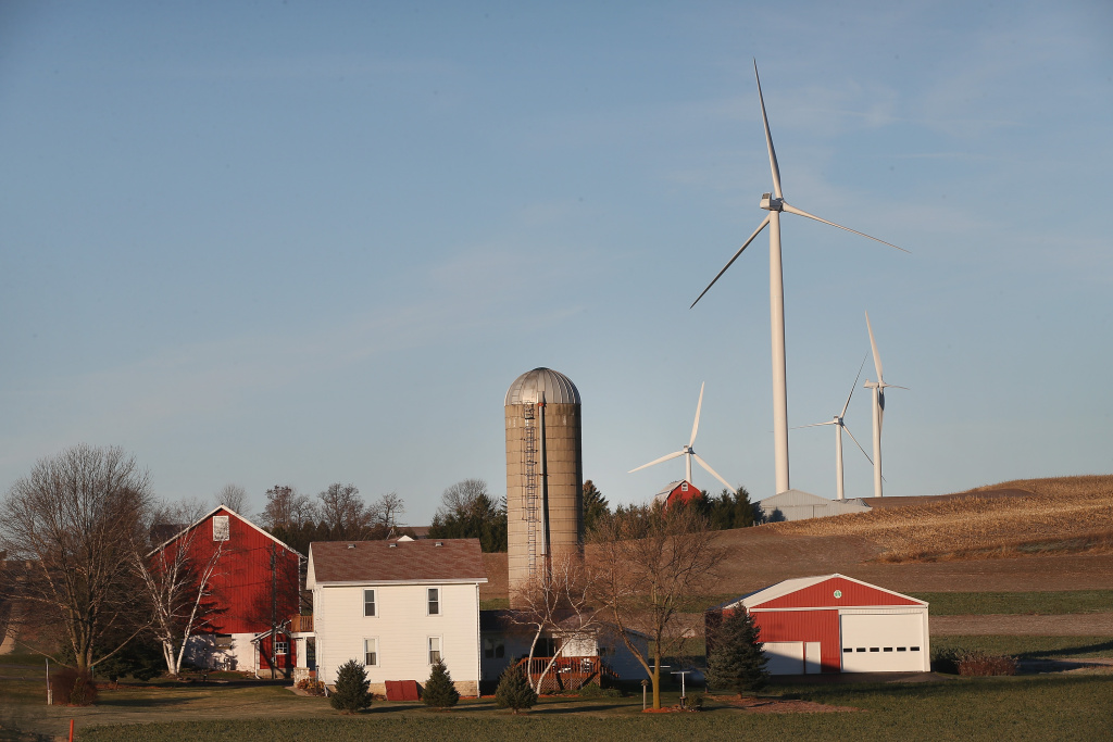 Wind turbines rise up above farmland on the outskirts of the state capital on November 19, 2013 near Middleton, Wisconsin.