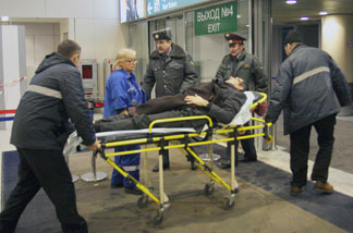Parmedics evacuate a wounded person from Moscow's Domodedovo International Airport on Jan. 24, 2011, after an explosion killed at least 35 people.