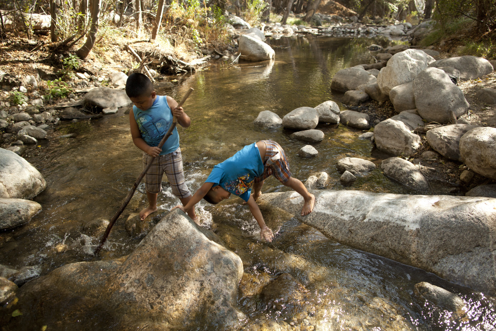 Angel Torres, 7, and his brother, Kevin, 6, play in a river in the San Gabriel Mountains. President Obama designated part of the area in the Los Angeles National Forest a national monument.