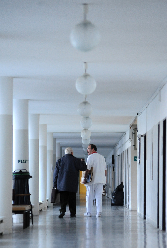 A doctor (R) talks with a man in a corridor of the biggest Bratislava's hospital, Kramare on November 29, 2011.