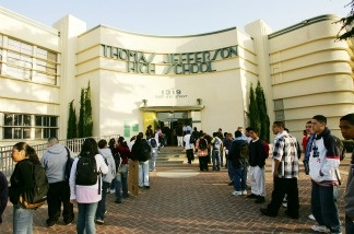 Students line up to pass through a security check point in the aftermath of two apparent racially motivated student brawls at Thomas Jefferson High School April 21, 2005 in Los Angeles, California.