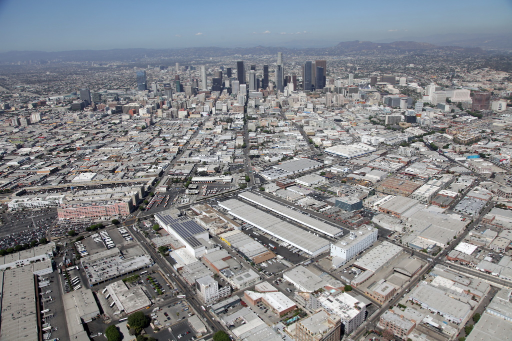 An aerial photo shows the plot purchased by Irvine-based developer SunCal. The two long, white buildings that appear diagonally near the center sit on the property and have been used as food distribution centers.