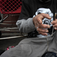 "FILE - In this Monday, May 6, 2013 file photo, a drug addict prepares a needle to inject himself with heroin in front of a church in the Skid Row area of Los Angeles. It's not a rare scene on Skid Row to spot addicts using drugs in the open, even when police patrol the area. Jim Hall, an epidemiologist who studies substance abuse at Nova Southeastern University in Fort Lauderdale, Fla. says, the striking thing about heroin's most recent incarnation in the early 21st Century, is that a drug that was once largely confined to major cities is spreading into suburban and rural towns across America, where it is used predominantly by young adults between the ages of 18 and 29. ""We haven't really seen something this rapid since probably the spread of cocaine and crack in the mid-1980s,"" Hall said. (AP Photo/Jae C. Hong)"