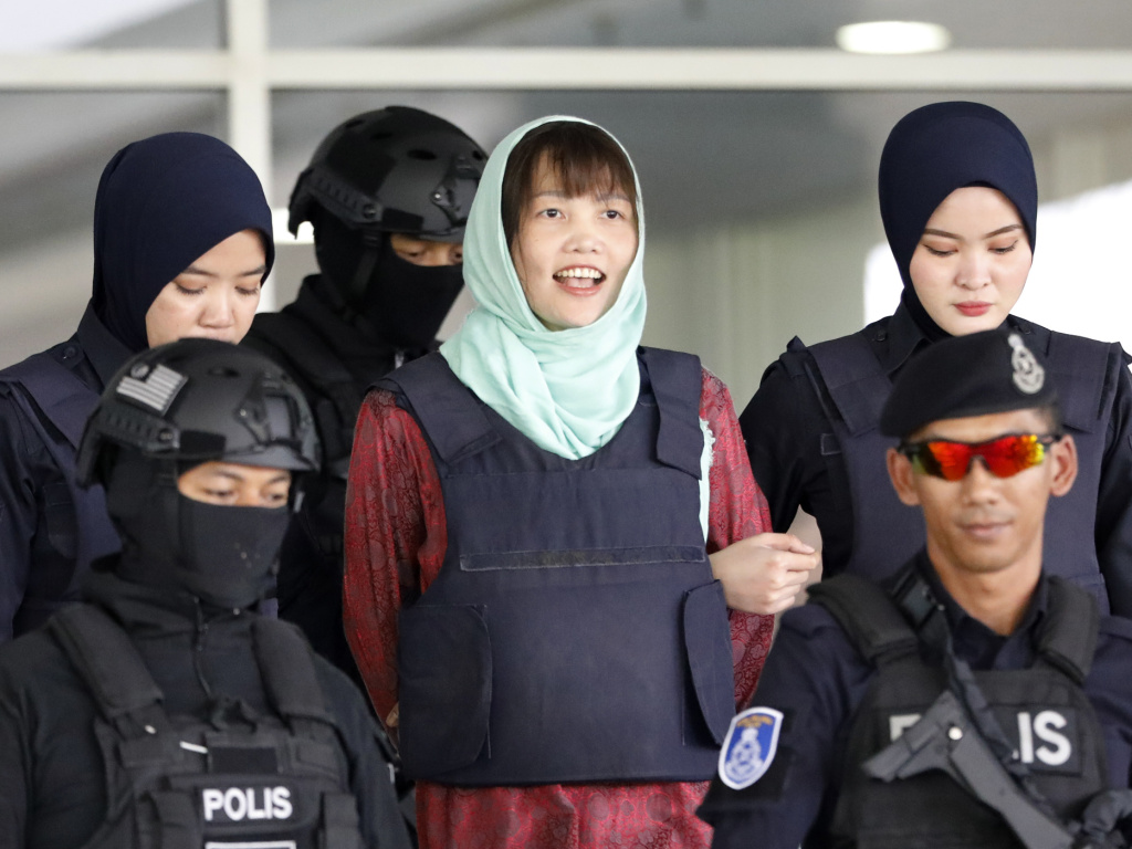Vietnamese Doan Thi Huong, center, leaves the court in Shah Alam, Malaysia, on Monday.