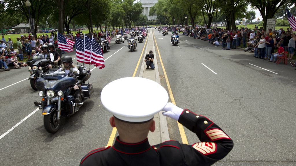 U.S. Marine Tim Chambers salutes to participants in last year's Rolling Thunder motorcycle demonstration.