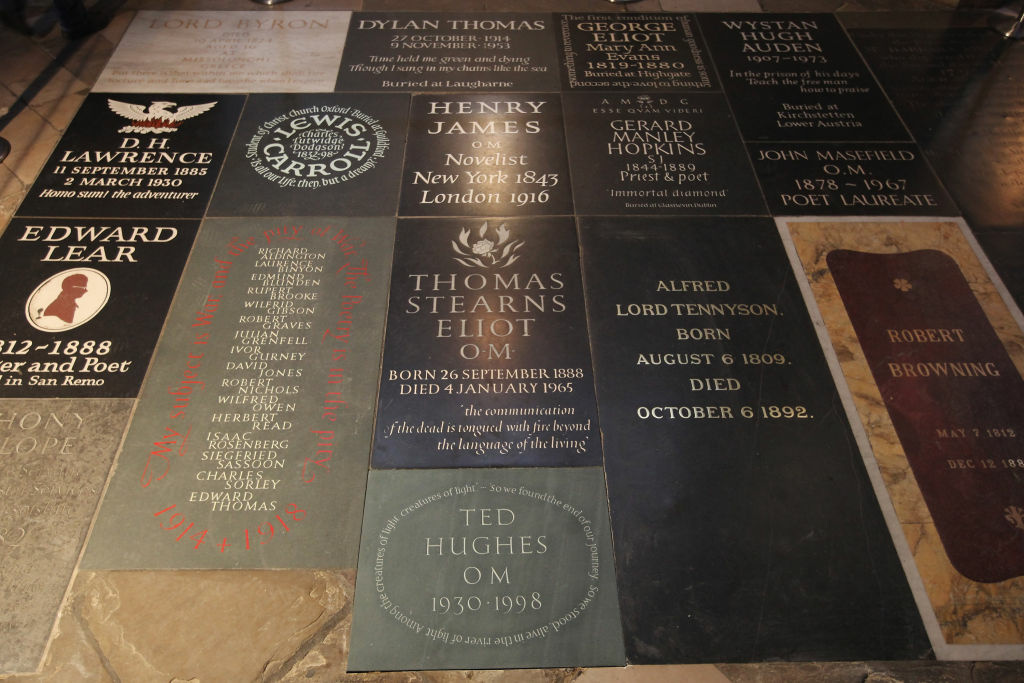 A view of a new memorial to Poet Laureate Ted Hughes in Poets' Corner inside Westminster Abbey on December 2, 2011 in London, England. The Welsh slate carved memorial, to the former Poet Laureate Ted Hughes who died in 1998, sits in Poets' Corner alongside other British literary giants including Lord Alfred Tennyson, D.H. Lawrence, T.S. Eliot and William Shakespeare. It will be unveiled at a ceremony in Westminster Abbey tomorrow evening with guests including his widow, Carol Hughes, and poet Seamus Heaney attending.