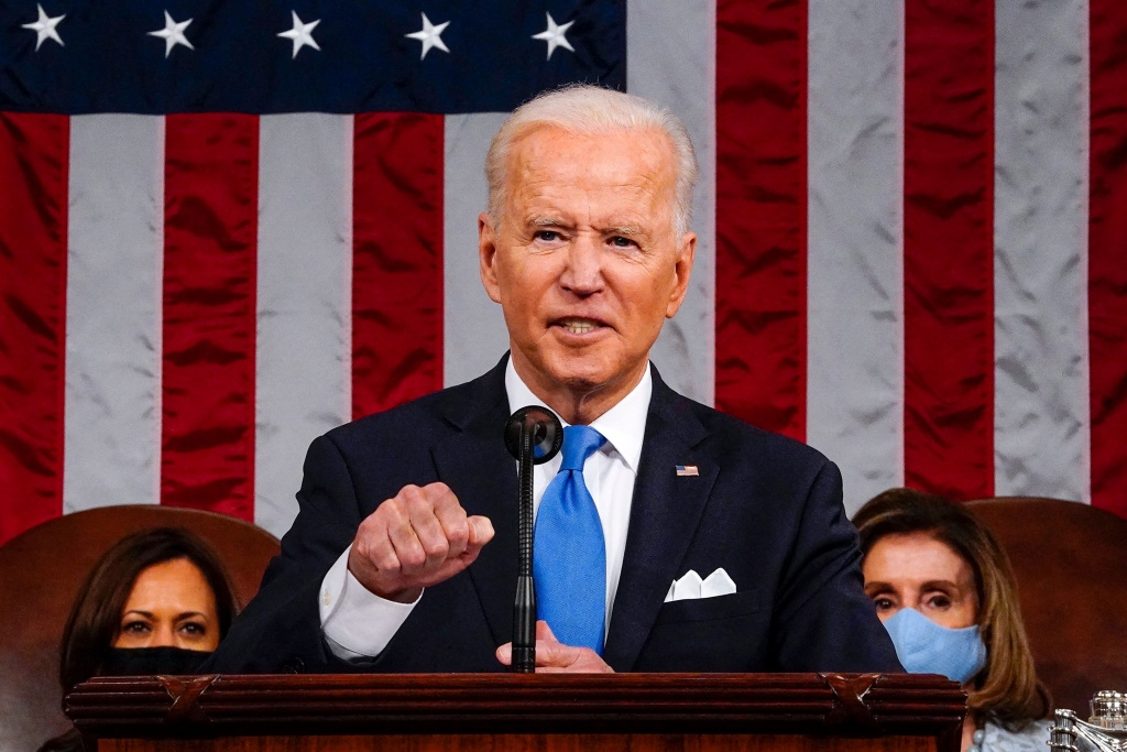 US President Joe Biden, flanked by US Vice President Kamala Harris (L) and Speaker of the House of Representatives Nancy Pelosi (R), addresses a joint session of Congress at the US Capitol in Washington, DC, on April 28, 2021.