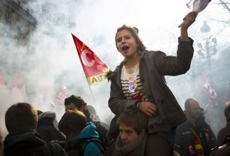 A high school student waves a flag during a demonstration on October 20, 2010, in front of the French Senate in Paris, to protest governemental pensions reform.