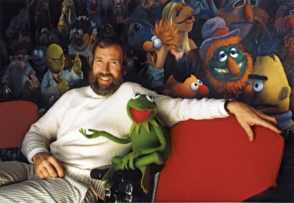 Jim Henson and his iconic creation, Kermit the Frog, in front of a mural by Coulter Watt. ©Disney/Muppets.