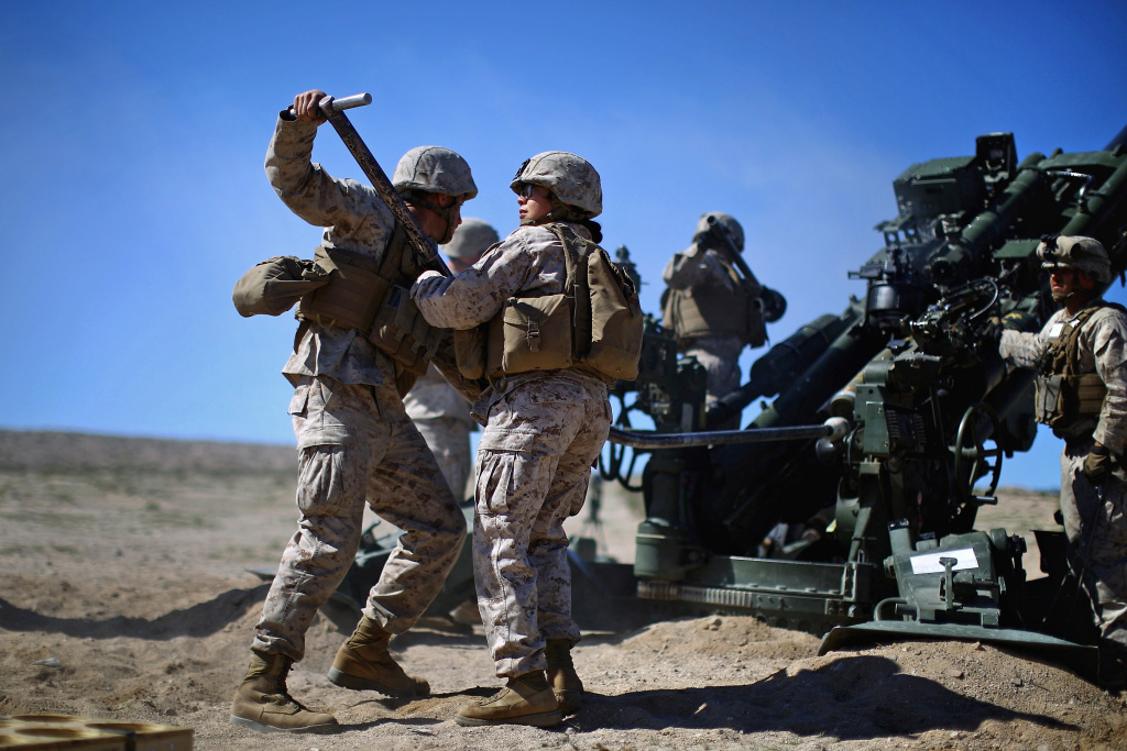 Pentagon chief Ash Carter is expected to announce that women can now serve in frontline combat posts. Here Carolina Ortiz moves away from a 155 mm artillery piece after loading it during a live-fire exercise at the Marine base in Twentynine Palms, Calif., earlier this year, in a a months-long study of how women might perform in ground combat jobs.
