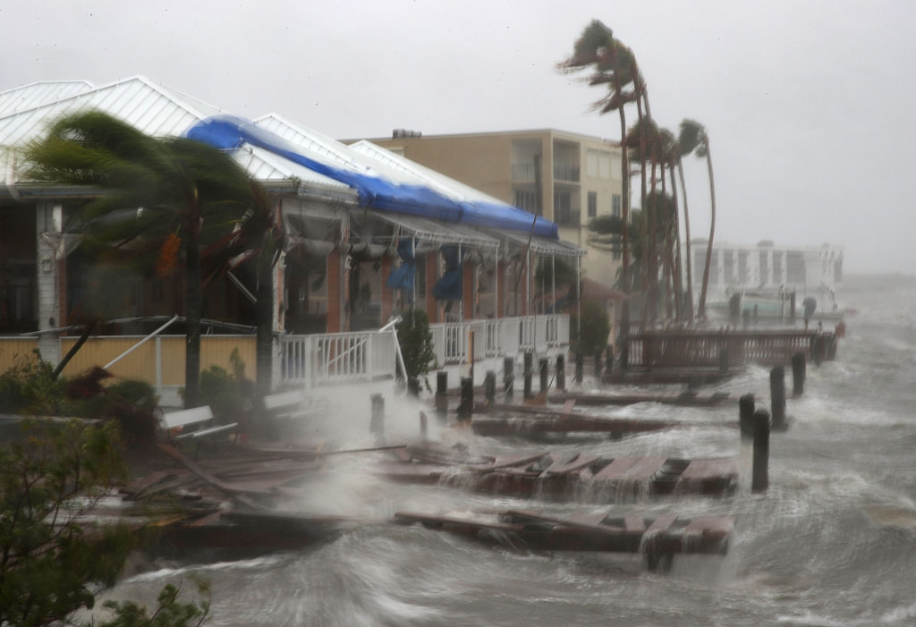 Heavy waves caused by Hurricane Matthew pounds the boat docks at the Sunset Bar and Grill, October 7, 2016 on Cocoa Beach, Florida.