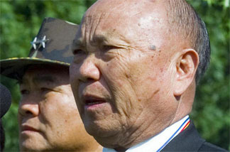 Former Hmong Gen. Vang Pao (right) in May 2000 during a wreath-laying ceremony at the Vietnam Memorial in Washington, D.C.
