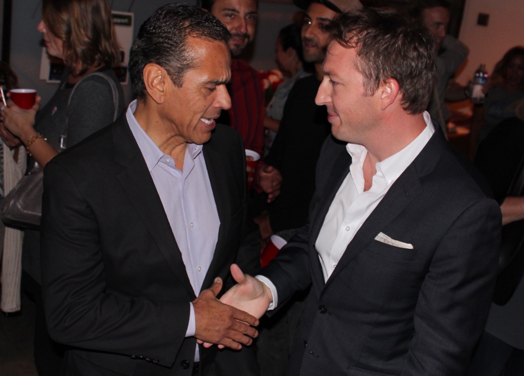 L.A. Unified School Board candidate Nick Melvoin, right, shakes hands with former Mayor Antonio Villaraigosa during Melvoin's election night party in Venice.