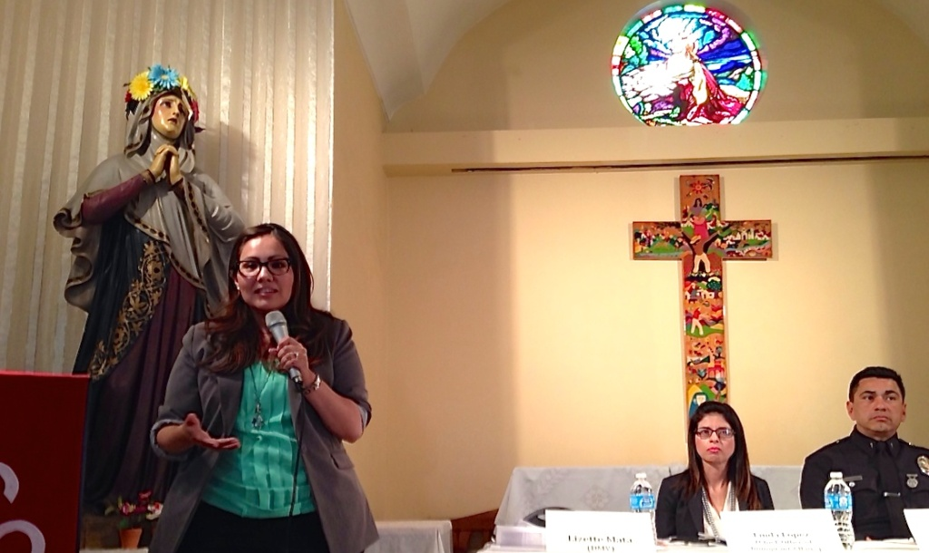Lizette Mata of the California DMV addresses meeting-goers at the Dolores Mission in Boyle Heights.