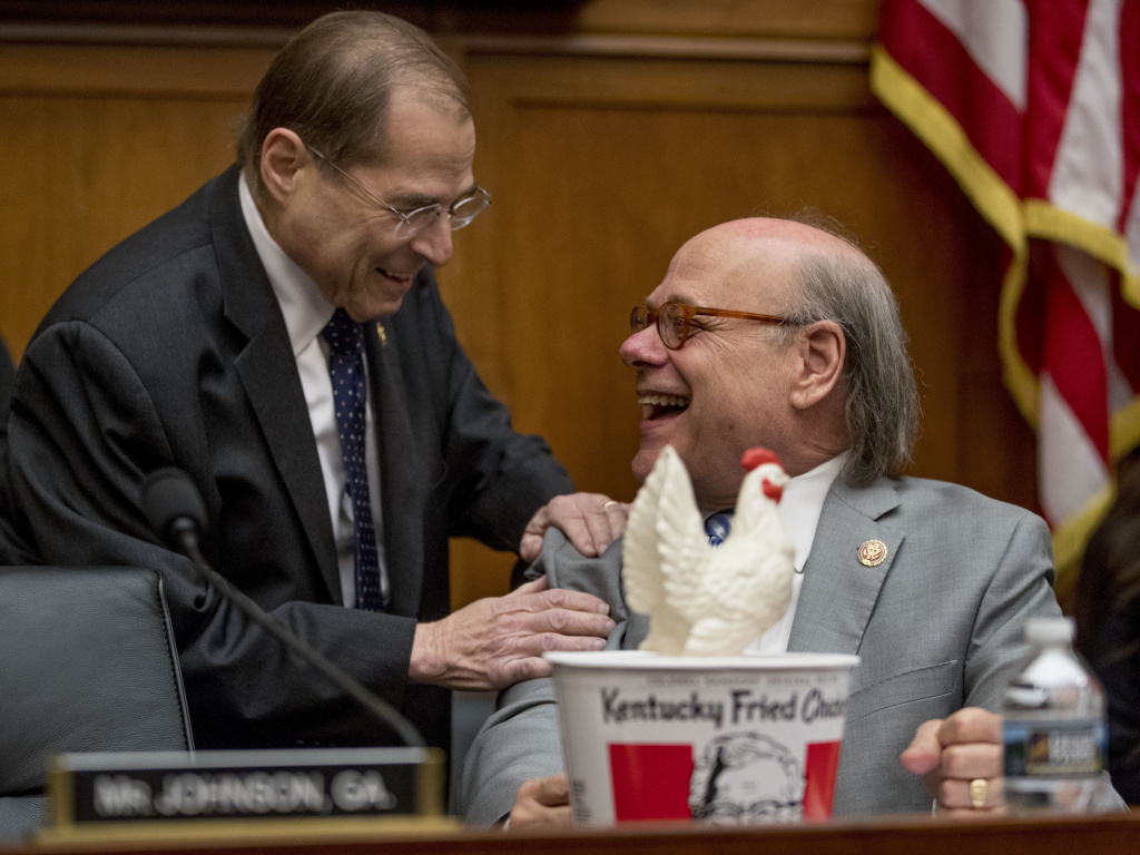 Judiciary Committee Chairman Jerrold Nadler, D-N.Y., left, laughs with Rep. Steve Cohen, D-Tenn., right, after Cohen arrived with a bucket of fried chicken and a prop chicken because Attorney General William Barr did not appear before the committee as requested.