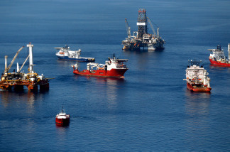 Ships work near the site of the BP Deepwater Horizon oil spill in the Gulf of Mexico off the coast of Louisiana in April 2010.