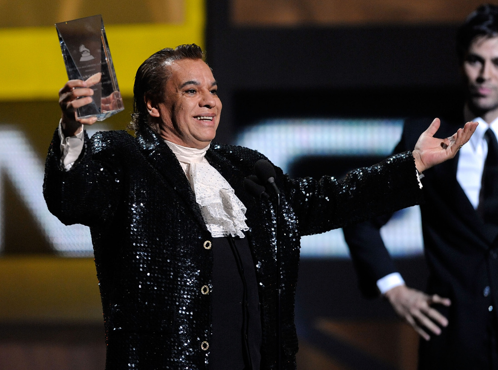 Singer Juan Gabriel accepts the Person of the Year award from singer Enrique Iglesias onstage during the 10th annual Latin GRAMMY Awards held at Mandalay Bay Events Center on November 5, 2009.