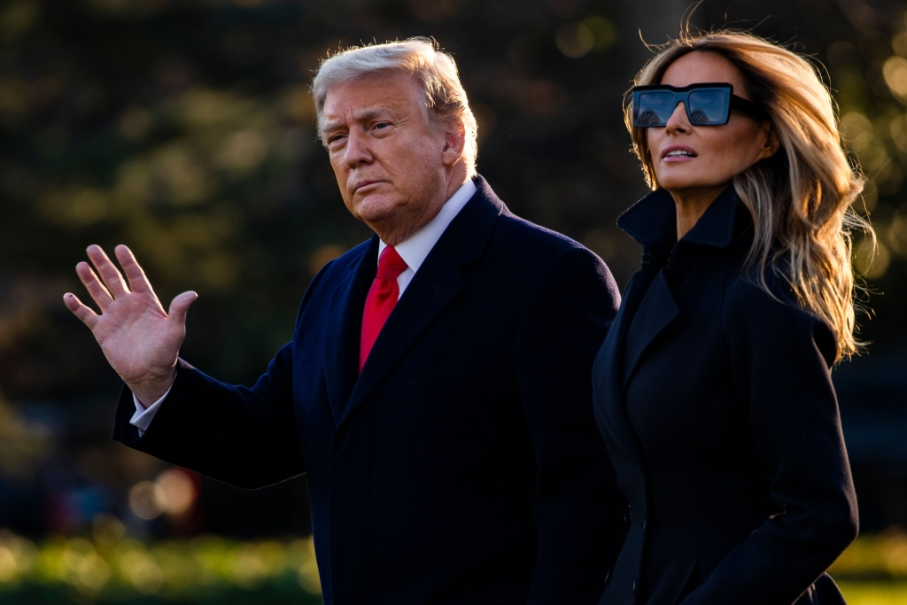 President Donald Trump and First Lady Melania Trump walk towards Marine One as they depart the White House en route to Mar-a-Lago, the President's private club, where they will spend Christmas and New Years Eve in Washington, DC on December 23, 2020.