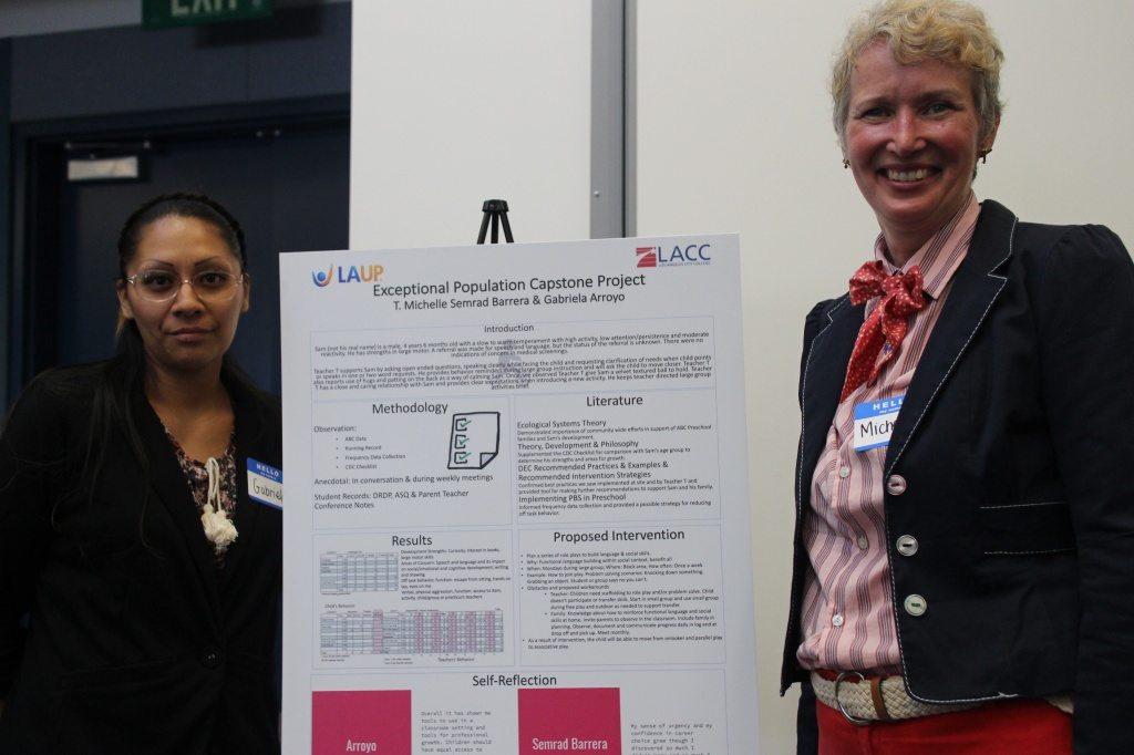 Gabriela Arroyo and Michelle Semrad Barrera pose next to a poster they presented to leaders of LAUP and L.A. City College before graduation. They worked together to develop an intervention plan for a preschooler with developmental delays.