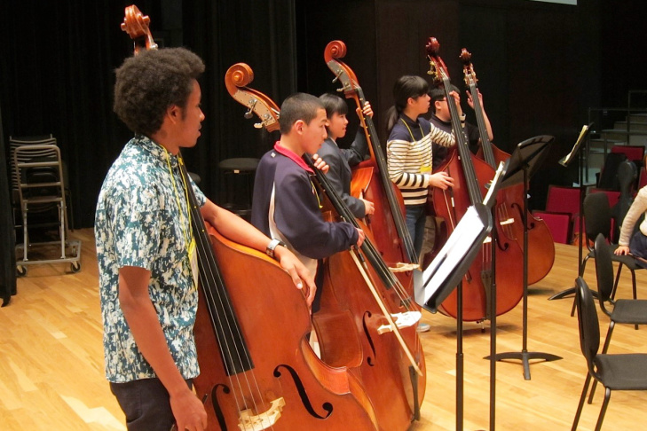 Members of YOLA rehearse with members of the Soma Children's Orchestra and El Sistema Japan.
