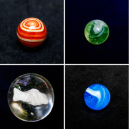 Marbles from the collection of Doug Watson. Top row from left: hand-cut agate, green slag, handmade German latticino, champion furnace swirl. Bottom row: German handmade flame-polished sulphide, aqua slag, hollow steelie, handmade flame-polished German on