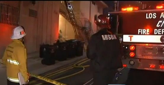 Firefighters investigate the cause of a fatal apartment fire in Chinatown.