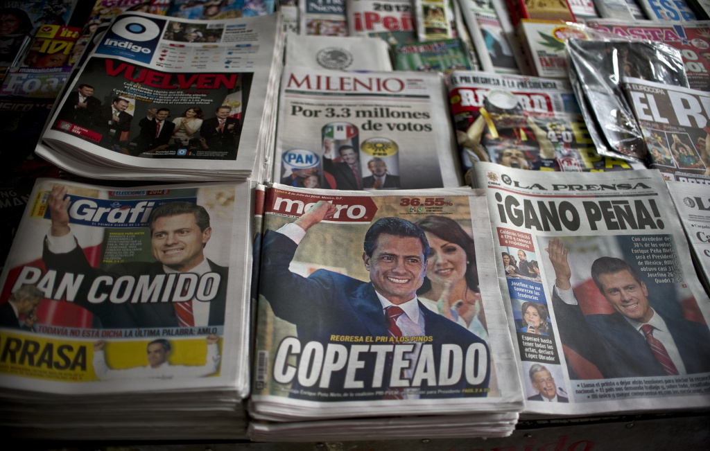 Front pages of newspapers with information on the new Mexican president for the Institutional Revolutionary Party (PRI), Enrique Pena Nieto, on July 2, 2012. Pena Nieto, the youthful candidate of the party that governed Mexico for decades, claimed victory late on July 1 in the country's presidential election.