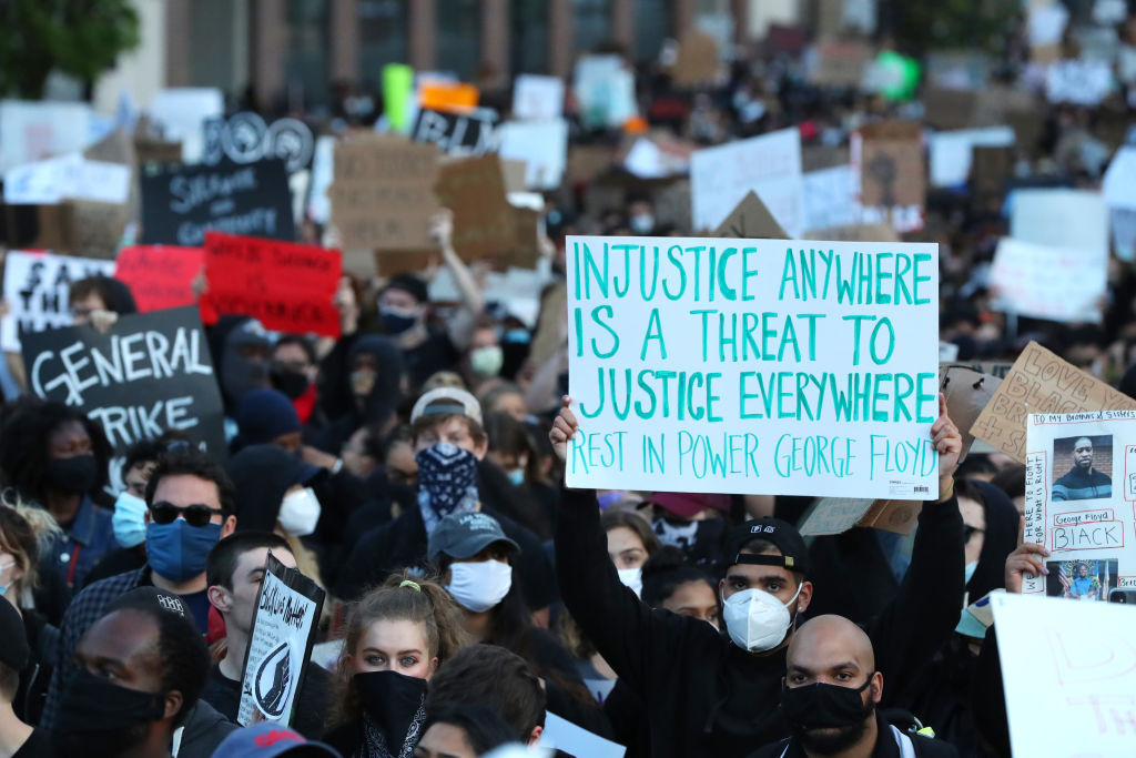 Demonstrators protest in response to the recent death of George Floyd on May 31, 2020 in Boston, Massachusetts.