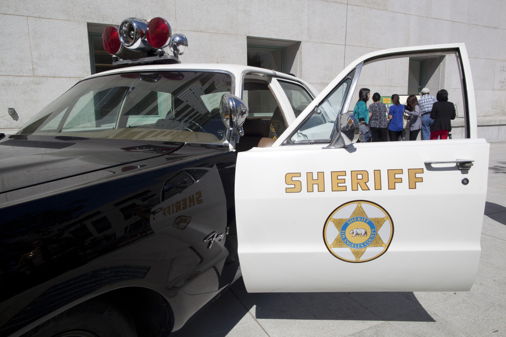 An old Los Angeles County Sheriff vehicle is parked outside of the Hall of Justice.