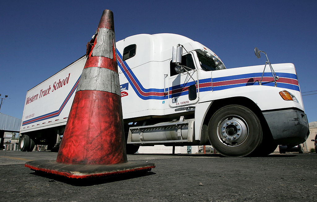 A semi-truck manuevers around a traffic cone during training at the Western Trucking School August 3, 2005 in Turlock, California.