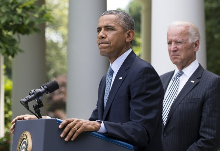 President Barack Obama speaks on immigration reform beside U.S. Vice President Joe Biden (R) in the Rose Garden of the White House on June 30, 2014. Some GOP lawmakers opposed to Obama's plans to take executive action on immigration have suggested it could lead to a budget battle this fall.