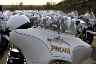 The Harley Davidson motorcycle of the LAPD (Los Angeles Police Department) stands beside the Yamahas of the French police at the Davis training Center in Granada Hills, north of Los Angeles, CA, 10 January 2007.