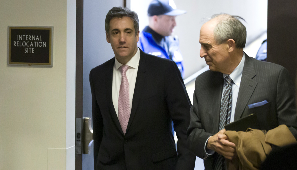 Michael Cohen (left), President Trump's former lawyer, arrives to testify before a closed hearing of the Senate intelligence committee, with his lawyer Lanny Davis on Tuesday.